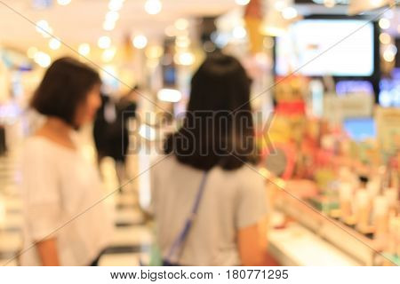 Blurred Image Of Women Buy Sets Of Makeup In Department Store Shopping Mall, Image Blur Defocused Ba
