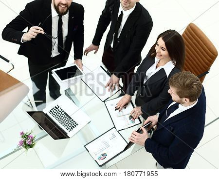 top view of successful business team is preparing for presentation of a new financial project of the company.the photo has a empty space for your text.
