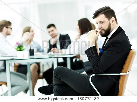financial Manager of the company on the background of the working meeting the business team.the photo has a empty space for your text