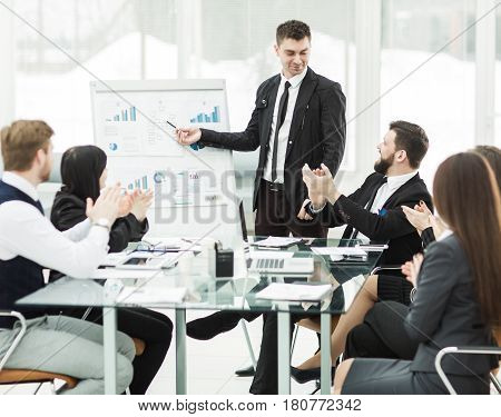 business team gives a presentation of a new financial project for the business partners of the company . the photo has a empty space for your text.