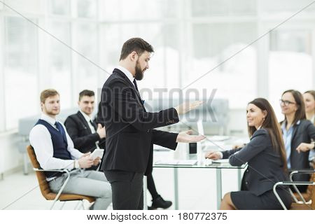 senior Manager of the company holds a working meeting with business team in modern office. the photo has a empty space for your text.