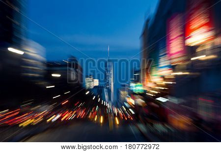 Abstract blurred night lights background of a busy street scene and the Manhattan skyline in New York City NYC