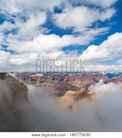 Grand Canyon National Park landscape scene with rare temperature inversion causing a layer of fog to fill the canyon