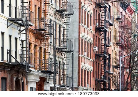 Colorful row of historic buildings with windows and fire escapes in the East Village of Manhattan New York City NYC