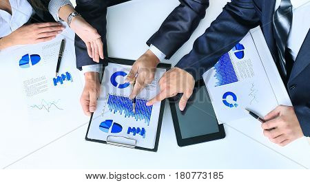 Meeting at the office of a friendly business team, analyzing documents and schedules in the workplace