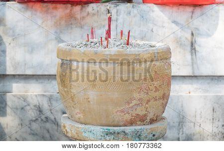 Burning sticks joss in pot at temple