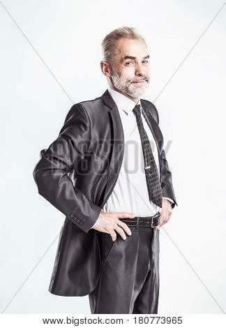 confident businessman on a light background . the photo has a empty space for your text