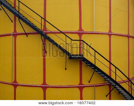 closeup of yellow cistern whit black metal steps poster