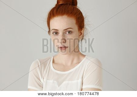 Headshot Of Cute Girl With Pleasant Features Posing At Grey Wall. Attractive Young Caucasian Woman W