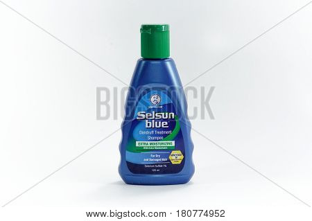 Labuan,Malaysia-Apr 8,2017:Bottle of Selsun blue,dandruff treatment shampo in Labuan,Malaysia.This shampoo is specifically formulated to control scaling,flaking & itching scalp.