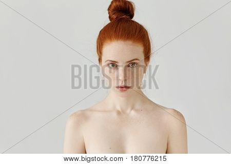Isolated Portrait Of Beautiful Young Caucasian Redhead Woman With Hair Bun And Perfect Clean Skin Wi