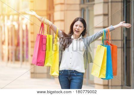 Happy Shopping Woman On Urban Street