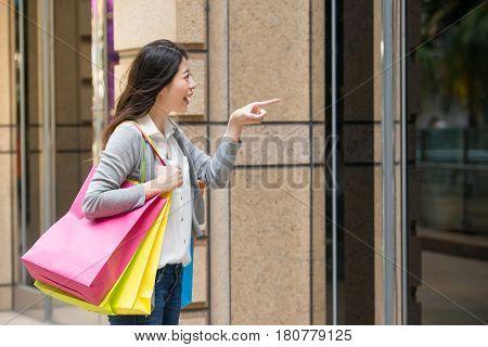 Woman Looking At Window Display At Store Shop