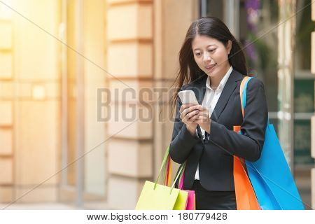 Hands Of Businesswoman Using Mobile Phone