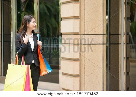 Shopping Businesswoman Looking At Window Display