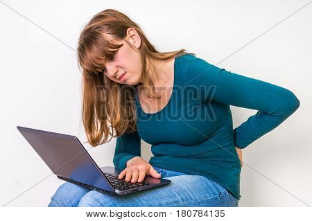 Woman Is Suffering From Back Pain - Bad Posture Concept