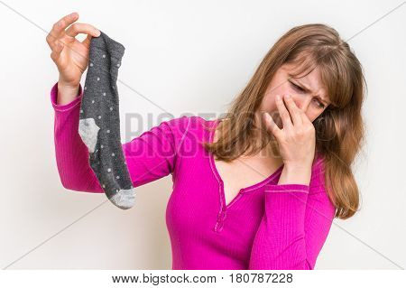 Woman Holding Dirty Stinky Socks