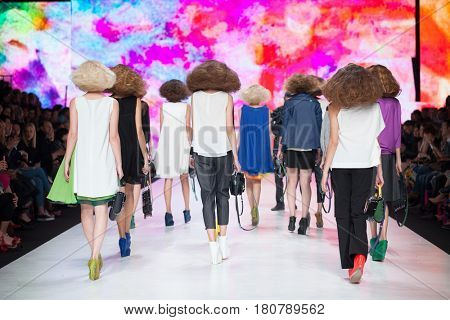 ZAGREB, CROATIA - APRIL 01, 2017: Fashion models wear clothes designed by Marina Design and bags designed by Marija Ivankovic at the 'Fashion.hr' fashion show