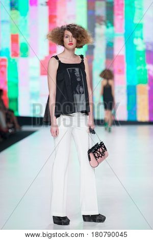 ZAGREB, CROATIA - APRIL 01, 2017: Fashion model wearing clothes designed by Marina Design and a bag designed by Marija Ivankovic at the 'Fashion.hr' fashion show