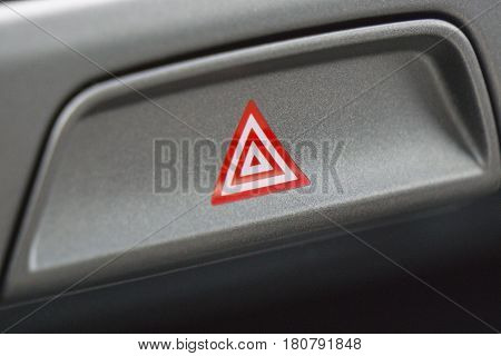 Detail of a warning button in a car.