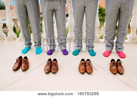 Men in colorful socks. Funny wedding photos. Wedding in Montenegro.