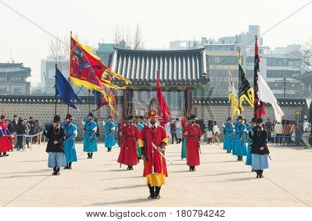 Seoul, South Korea - March 30, 2017: Royal guards in traditional clothing, during the opening and Closing of the Royal Palace Gates and Royal Guard Changing Ceremony.