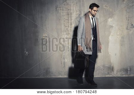 Cool Sharply dressed businessman in dark studio