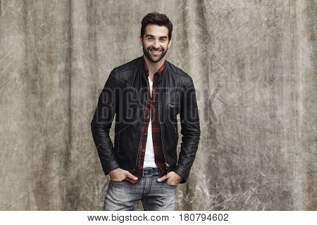 Jeans and jacket guy in studio smiling