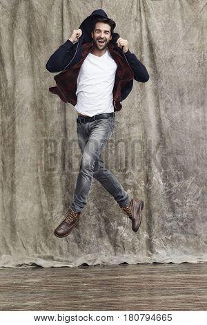 Jumping for joy guy in studio shot