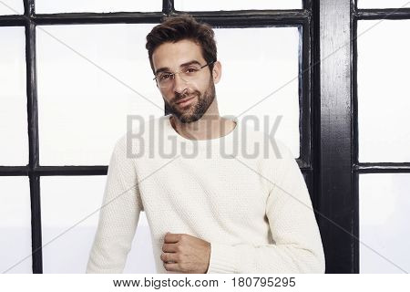 Dude in white sweater and spectacles portrait