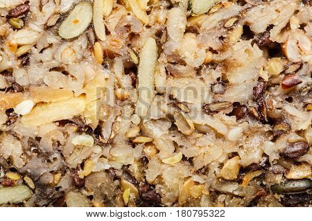Food textures and patterns concept. Detailed closeup of whole grain bread with many big grains