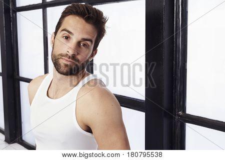 Handsome Stubble and vest in studio portrait