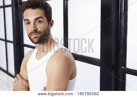 Vest and stubble guy in studio portrait
