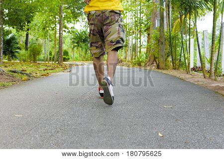 Body part of man,Walk or run for exercising in public park.Concept of health.