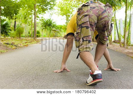 Concept of start man with exercising in public park.Concept of health.