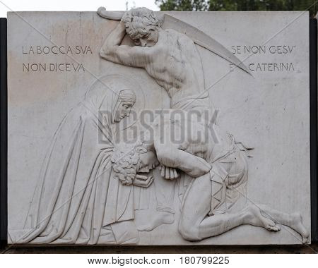 ROME, ITALY - SEPTEMBER 05: Relief of Saint Catherine of Siena near Sant Angelo Castle in Rome, Italy on September 05, 2016.