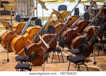 Vintage music instruments old bass viols on stage