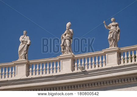 ROME, ITALY - SEPTEMBER 02: St. Ignatius Loyola, Remigius and Apollonia, fragment of colonnade of St. Peters Basilica. Papal Basilica of St. Peter in Vatican, Rome, Italy on September 02, 2016.