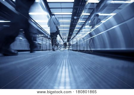Movement of escalator with Working people walking