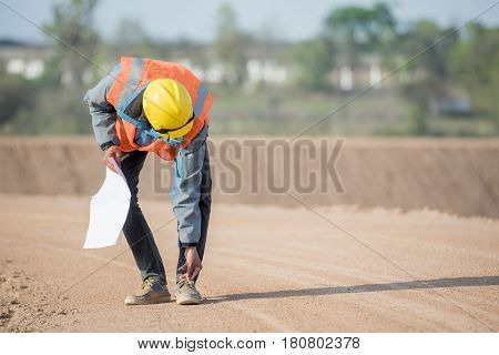 Civil engineer in safety uniform shoe rack in construction site