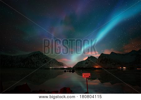 Aurora, north light Skagsanden  beach, Lofoten islands, Norway.