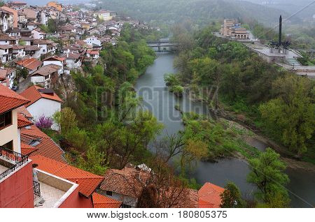 VELIKO TARNOVO BULGARIA - APRIL 8 2017: The Yantra river residential area and the monument of the Assens in the early spring