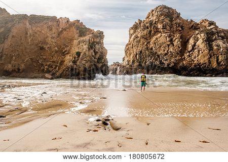 Man at Pfeiffer Beach, Big Sur, California, USA