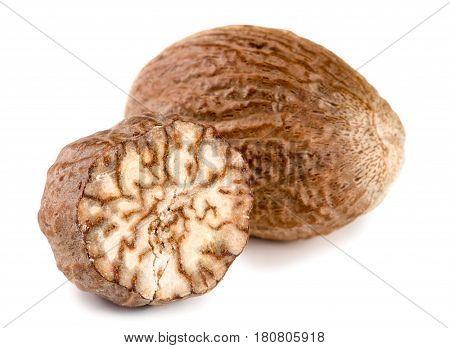 Two nutmeg isolated on white background macro.