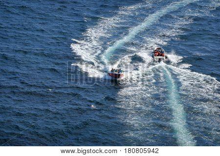 JEJU ISLAND SOUTH KORIA NOVEMBER 19 2015 ; speed boat for tourist by the coast of Jeju Island South Korea