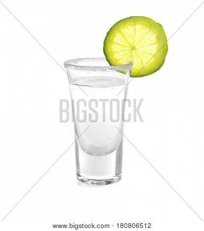 Tequila shot with juicy lime slice and salt on white background