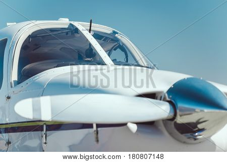 Business airplane white propeller closeup outdoors against blue sky