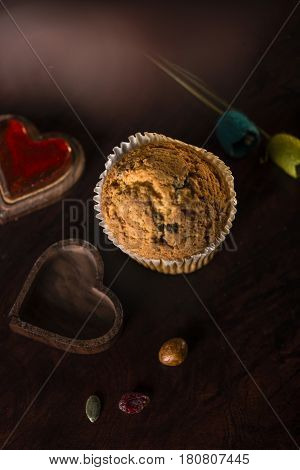 gluten free muffin over a wooden table in a dark set
