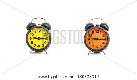 Closeup yellow alarm clock and orange alarm clock for decorate show a quarter past nine o'clock or 9:15 a.m. isolated on white background