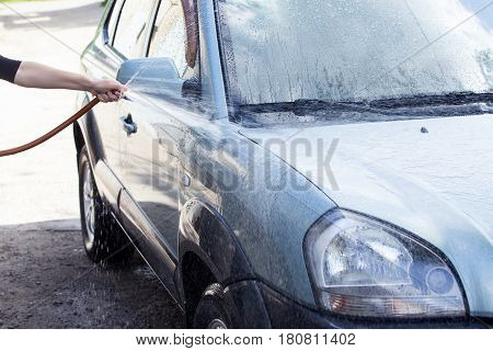 the car is washing in soap suds